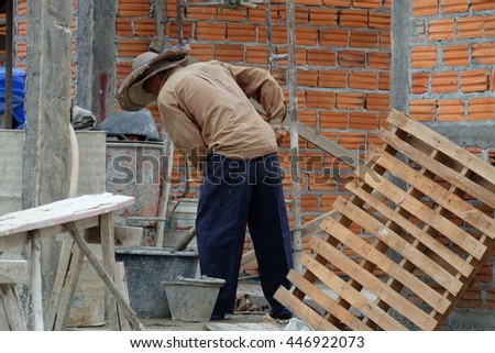 Workers are building a house