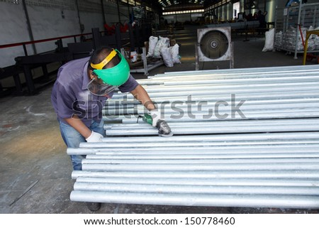 Workers are finishing a steel pipe - stock photo