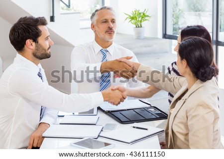 Workers are holding their hands at work - stock photo