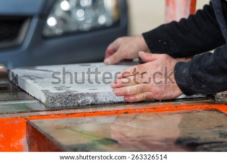 Workers are working, cutting marble cutter - stock photo