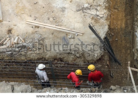 Workers at a building construction site