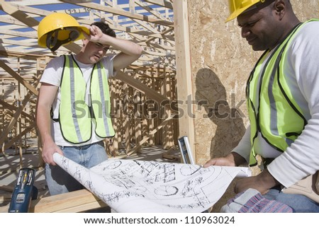 Workers at construction site - stock photo