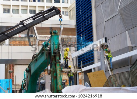 Workers at work at a construction site. Singapore