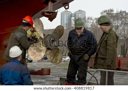 Workers   Brigade   puts  refurbished  screw  on  the  sea  boat
