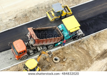 Workers constructing road with asphalt view from above