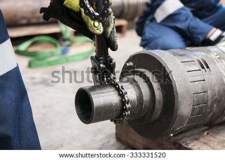 Workers drilling for oil  Training - stock photo