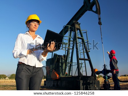 Workers in an Oilfield, teamwork - stock photo