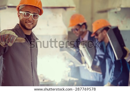 Workers in industrial factory - stock photo