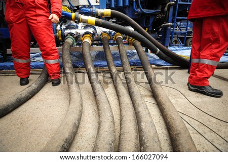 workers in overalls on an industrial plant - stock photo