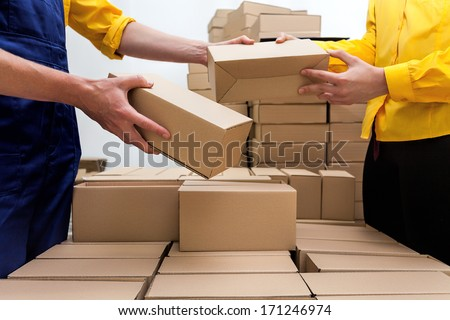 Workers in parcel delivery company preparing a deliver - stock photo