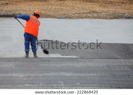 workers in the construction of the building foundation. laying warm floors. Belarus, Minsk, Oktober,8,2014