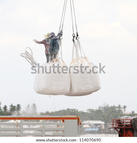 workers loading cargo in to the truck - stock photo