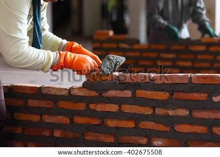 Workers masonry Clay brick to wall. - stock photo