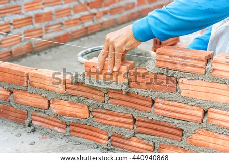 Workers masonry Clay brick to wall