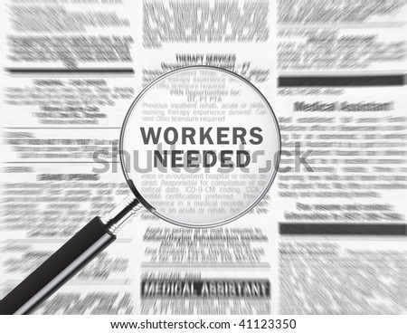 Workers needed ad through a magnifying glass - stock photo