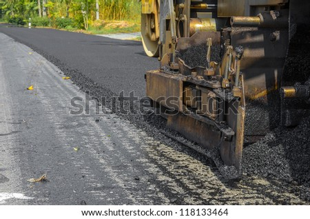 Workers on a road asphaltic in Thailand - stock photo