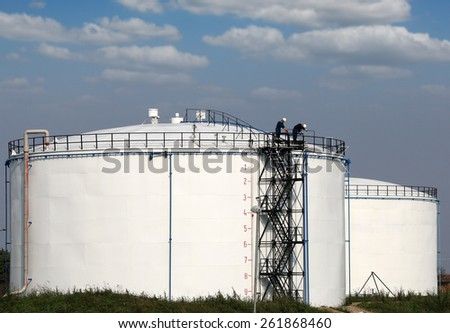 workers on oil tank industry zone - stock photo