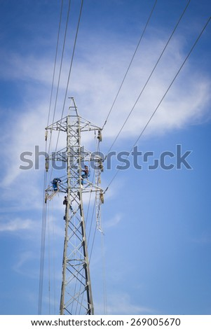 Workers repairing a high voltage industrial power energy line. Great for energy, safety and technology themes. : Almada, Portugal - September 23, 2008  - stock photo