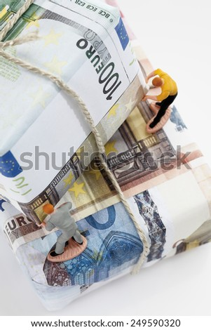 Workers sorting packages of euro notes - stock photo