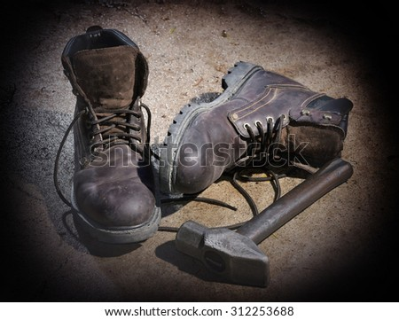 Workers still-life with shoes and hammer - stock photo