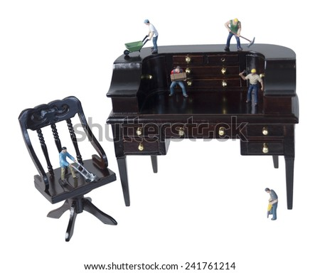 Workers using Teamwork and Tools on a desk to get job done - path included - stock photo