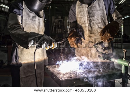 Workers Welding steel in the factory