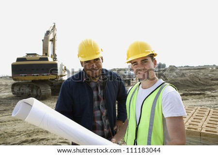 Workers with a blueprint - stock photo