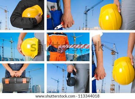 workers with equipment on building background sets - stock photo