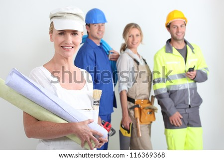 workers with one in the foreground - stock photo