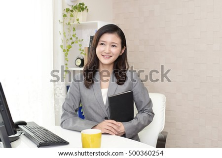 Working Asian business woman