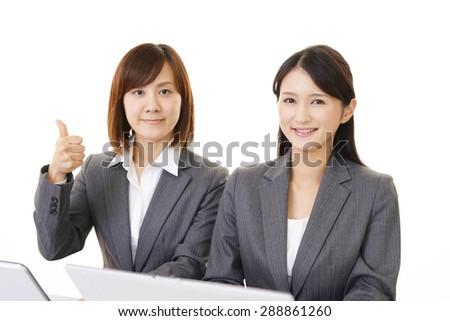 Working Asian business women - stock photo