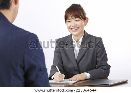 Working Asian woman - stock photo