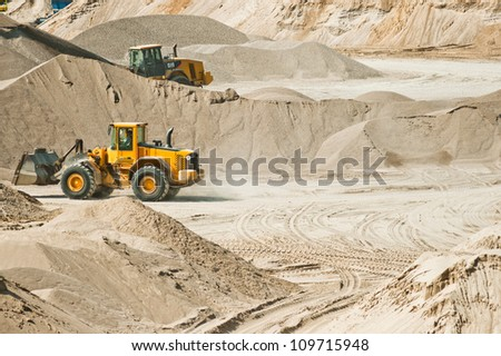 Working at gravel plant - stock photo