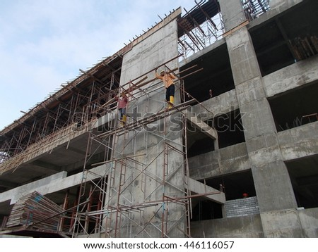 Working at height scaffolding without safety harness and proper platform. Safety conceptual.