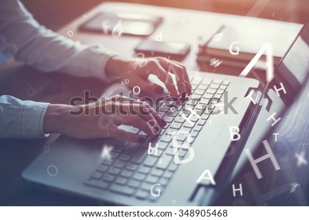 Working at home with laptop woman writing a blog. Female hands on the keyboard. - stock photo