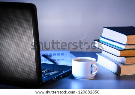 working at night, laptop with documents and cup of coffee on table - stock photo