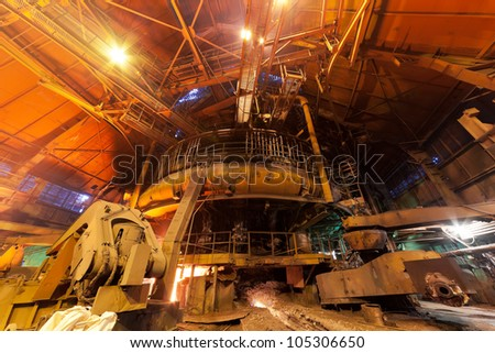 Working blast furnace at the metallurgical plant - stock photo