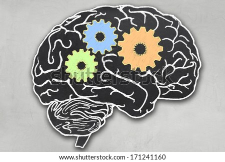 Working Brain with Clipping Path in Blackboard Style - stock photo