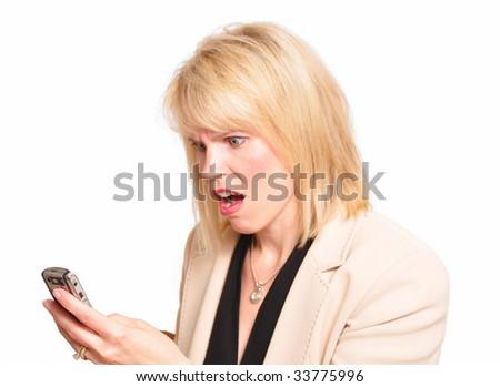 Working businesswoman receiving shocking news - stock photo