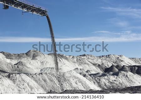 working conveyor belt in a coal mine - stock photo