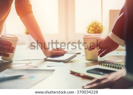 working day in office. two businessmen at work. - stock photo