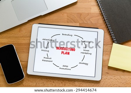 Working desk with digital tablet showing marketing planning - stock photo