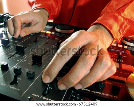 Working Disc jockey at party. Detail of a dj hands. - stock photo