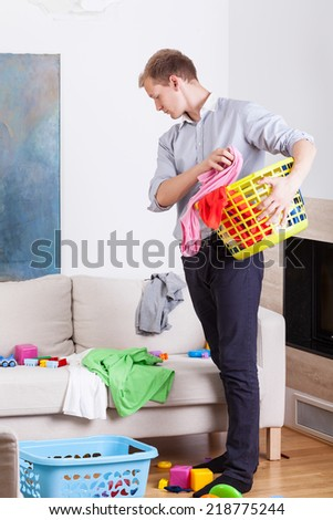 Working father before doing laundry at home