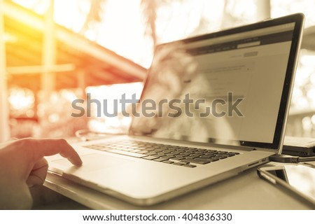 Working from home by using own computer. Vintage filter - stock photo