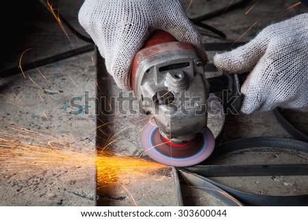 Working hand-held grinding steel. - stock photo