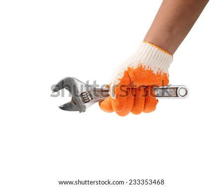 Working hand in glove holding wrench on a white background. - stock photo