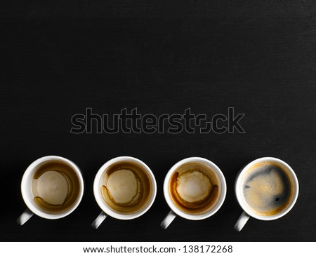 working hours. empty and full cups of fresh espresso, view from above - stock photo