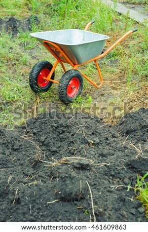 Working in the garden in a wheelbarrow transported soil