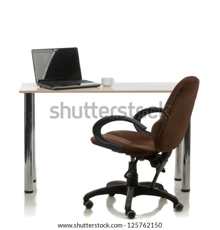 Working in the office, a chair, a table, a laptop. Isolated on white. - stock photo